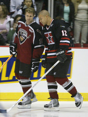 NHL hockey captains Naslund and Iginla chat during benefit hockey game in Vancouver.