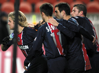 Paris Saint Germain players celebrate their first goal during their French Ligue soccer match against Rennes in Paris