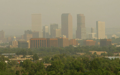 Smoke from the Hayman wildfire shrouds the Denver skyline, June 10, 2002. The Hayman wildfire is abo..