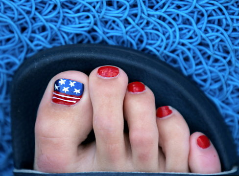 A U.S. flag adorns the toe nails of swimmer Marie Marsman before she competes in the 100 meter frees..
