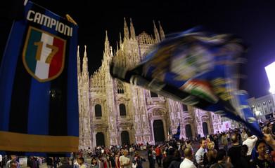 Fans of Italian Serie A team Inter Milan celebrate after team won league title in Milan