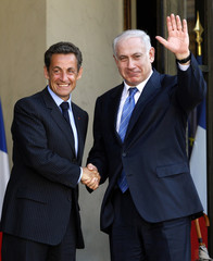 France's President Nicolas Sarkozy shakes hands with Israeli Prime Minister Benjamin Netanyahu at the Elysee Palace in Paris