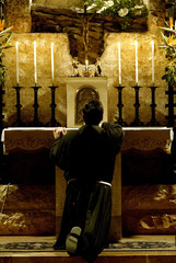Father Enzo Fortunato, a Franciscan monk prays for peace during a vigil at the tomb of Saint Francis..