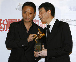 "Best leading actor Zhang Hanyu and director of ""Assembly"" Feng Xiaogang pose with Zhang's award at the 45th Golden Horse Awards in Taichung"
