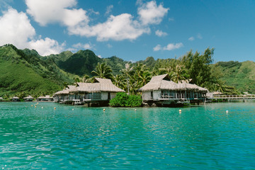 Bungalows over sea by mountains, Tahiti, South Pacific