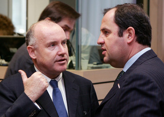 French Agriculture Minister Bussereau talks to his Austrian counterpart Proell in Brussels