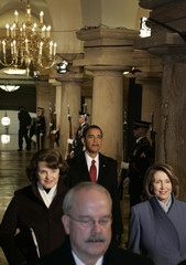 President-elect Barack Obama walks through the U.S. Capitol Crypt during the inauguration ceremony in Washington