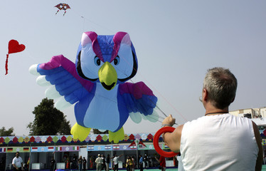 Kite-flying enthusiast flies kite on the second day of 19th International Kite festival in Ahmedabad
