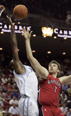 Raptors Bargnani shoots over Magic Ariza during first half NBA basketball game in Orlando