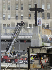 Workers prepare to move cross made with iron from World Trade Center Building Six in New York