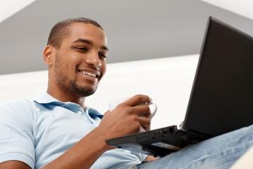 Young man using laptop computer