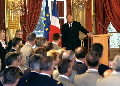 French President Jacques Chirac (Background) listens to the speech of the new Chief of Staff of the ..