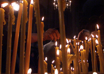 Orthodox Christians light candles inside a church in Sarajevo April 30. Bosnian Orthodox believers a..