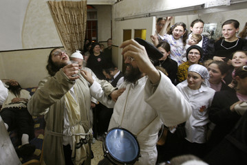 Ultra-Orthodox Jews dance together during celebrations for the Jewish holiday of Purim in the Mea Shearim neighbourhood of Jerusalem