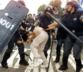 A SOUTH KOREAN PROTESTER IS ARRESTED BY RIOT POLICE IN SEOUL.