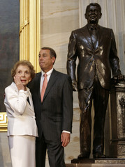 Former first lady Nancy Reagan wipes a tear in front of unveiled statue of former president Ronald Reagan in Washington