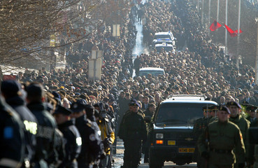 Mourners line the street during the funeral procession for Kosovo Albanian president Ibrahim Rugova in Pristinaova