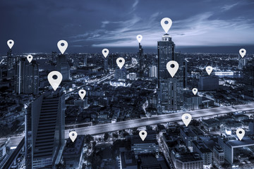 Map pin flat on blue tone Aerial view of cityscape Bangkok business district at twilight  background.