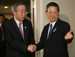 South Korea's Foreign Minister Ban is welcomed by Japanese counterpart Machimura in Kyoto.