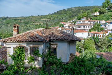 Old house and view on Siringe village, Izmir, Turkey