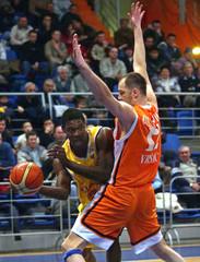 Brindley (L) of BK Venstpils Latvia is blocked by DJikanovic of Hemofarm during their basketball ...