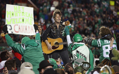 Cuddy of Blue Rodeo performs during the halftime show before the Alouettes play the Roughriders in the second half during the 97th CFL Grey Cup football game in Calgary