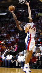 Heat guard Wade shoots over Pistons forward Prince during NBA action in Florida