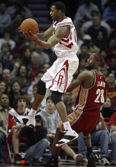 Houston Rockets forward McGrady goes to basket over Cleveland Cavaliers forward LeBron James during first period of NBA game in Houston