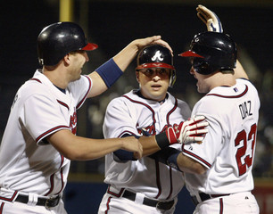Atlanta Braves Prado is congratulated by teammates Francoeur and Diaz after three-run home run off of Philadelphia Phillies Moyer in fifth inning of baseball game in Atlanta