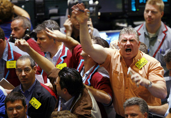 Traders work in Oil Futures pit at New York Mercantile Exchange