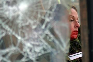 An 'injured' passenger seen through broken glass during exercise near Jajce
