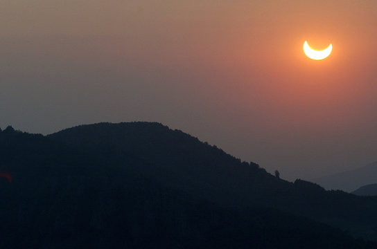 SOLAR ECLIPSE OVER THE HILLS OF THE RHODOPI MOUNTAINS IN BULGARIA.