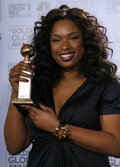 Jennifer Hudson holds her award backstage at the 64th annual Golden Globe Awards in Beverly Hills