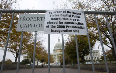 A closed sign is posted on a barricade surrounding the  U.S. Capitol in Washington the day before election day