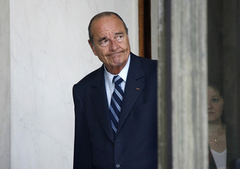 French President Jacques Chirac prepares to greet President Hosni Mubarak of Egypt at the Elysee Palace in Paris