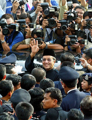 OUTGOING MALAYSIAN PM MAHATHIR MOHAMAD WAVES GOODBYE TO SUPPORTERSAFTER LEAVING OFFICE IN PUTRAJAYA.