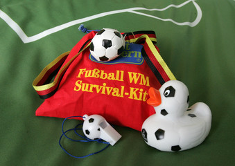 World Cup Survival-kit with fancy soccer accessories are pictured at a soccer-style decorated guest room of a hotel in Neumuenster