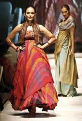 Models wear creations by Indonesian fashion designer Tarun Tahiliani during Jakarta Fashion Week