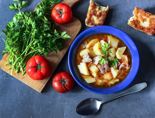 Thick potato soup with meat
