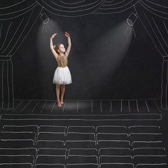 Baby girl dreaming a dansing ballet on the stage.