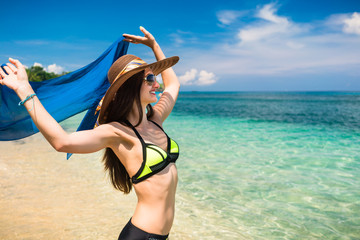 Woman tourist at tropical beach on vacation