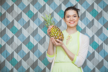 Freah young woman with juicy sweet pineapple