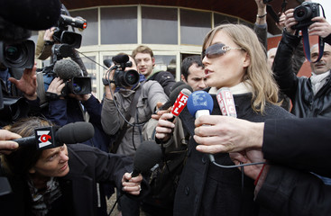 A woman, who identified herself as Claire, speaks to the press during a news conference in Marseille