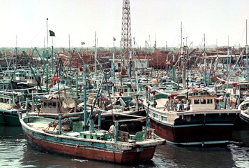 FISHING BOATS ARE ANCHORED AT KARACHI FISH HARBOUR AHEAD OF A TROPICAL CYCLONE.