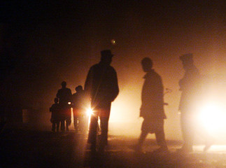 POLICEMEN AND FAMILY WALK ON STREET OF KABUL AFTER REMOVAL OF CURFEW.