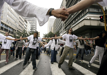 University students take part in a march of public workers, students and teachers in Bogota