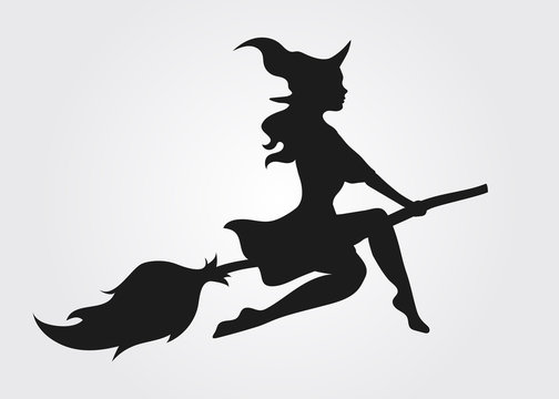 Silhouette of a witch flying on a broomstick
