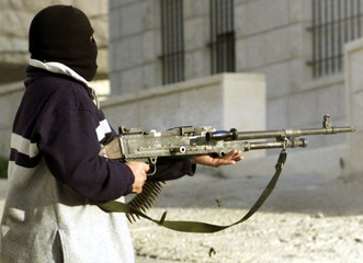 A PALESTINIAN GUNMEN TAKES POSITION TO SHOOT AT THE JEWISH SETTLEMENTGILO.