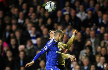 Chelsea's Bosingwa challenges Juventus' Molinaro during their Champions League soccer match in London