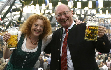 Social democratic chief candidate Maget and Bause of Bavaria's Green party pose during the opening ceremony of the Oktoberfest in Munich
